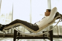 Businessman reclining on chair - Asia Images Group