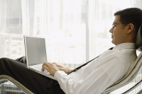 Businessman using laptop - Asia Images Group