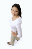 Woman with hands on hips, looking at camera - Asia Images Group