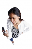 Woman looking at mobile phone, high angle view - Asia Images Group