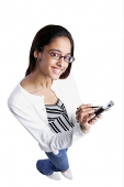 Woman using PDA, smiling, high angle view - Asia Images Group