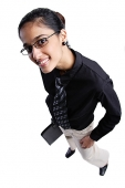 Business woman smiling at camera, high angle view - Asia Images Group