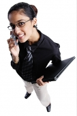 Business woman using mobile phone, smiling at camera, high angle view - Asia Images Group