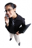 Business woman using mobile phone, high angle view - Asia Images Group