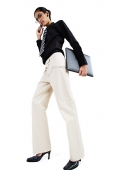 Business woman using mobile phone, carrying folder, looking at camera, low angle view - Asia Images Group