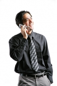 Businessman using mobile phone - Asia Images Group