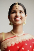 Woman in traditional Indian attire smiling, head shot - Asia Images Group