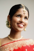 Portrait of woman in Indian sari, smiling - Asia Images Group