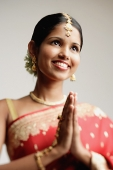 Woman in sari, hands together - Asia Images Group