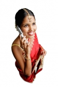 Woman in sari, using mobile phone, smiling - Asia Images Group