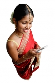 Woman in sari, using mobile phone, text messaging - Asia Images Group