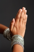 Close-up of woman's hands together in prayer position - Asia Images Group
