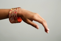 Close-up of woman's hand with bangles - Asia Images Group