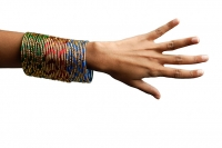 Woman's hand with many bangles on her wrist - Asia Images Group