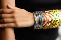 Woman's arm with colourful bangles - Asia Images Group