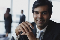 Businessman smiling at camera - Asia Images Group