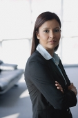 Businesswoman looking at camera, arms crossed - Asia Images Group