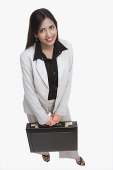 Businesswoman with briefcase - Asia Images Group