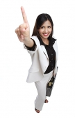 Businesswoman with briefcase, one finger pointing upwards - Asia Images Group