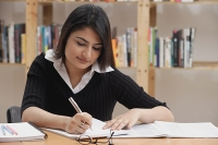 Woman studying in library - Asia Images Group