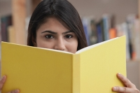 Woman with yellow book - Asia Images Group