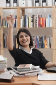 Woman in library, hand raised - Asia Images Group