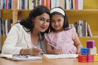 Woman and girl with books, looking at camera - Asia Images Group