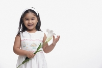 Young girl in white dress, holding a flower - Asia Images Group