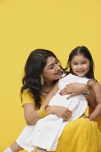 Woman embracing daughter - Asia Images Group