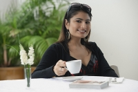 Woman in cafe, having a coffee - Asia Images Group