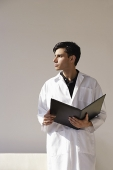 A man in a lab coat - Asia Images Group