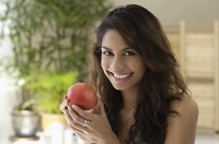 A woman eating fruit - Asia Images Group