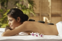 A woman relaxes at a spa - Asia Images Group