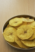A bowl of banana chips - Asia Images Group