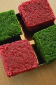 A dish of red and green burfi - Asia Images Group