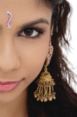 Cropped face of young woman with a bindi - Asia Images Group