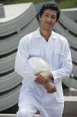 Man in work uniform, smiling at camera - Asia Images Group