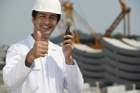 Man in work uniform gives thumb up - Asia Images Group