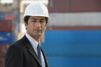 Man with helmet looking at camera - Asia Images Group