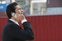Businessman talking on mobile phone - Asia Images Group
