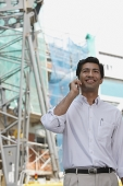 Man smiling while on mobile phone - Asia Images Group