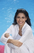 Woman sitting by the pool - Asia Images Group