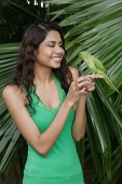 Woman with bird on hand - Asia Images Group