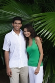Couple with arms around each other, smiling at camera - Asia Images Group