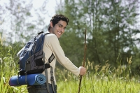 Young man hiking in the wilderness - Asia Images Group