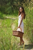 Young woman going for a picnic - Asia Images Group