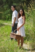 Young couple going for a picnic - Asia Images Group