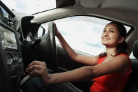 Young woman driving car - Asia Images Group