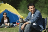 Young man camping with girlfriend - Asia Images Group