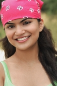 Young woman with bandana smiling at camera - Asia Images Group